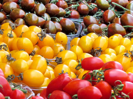 Red, yellow and brown cherry tomatoes on bazaar in Tel Aviv, Israel                               photo
