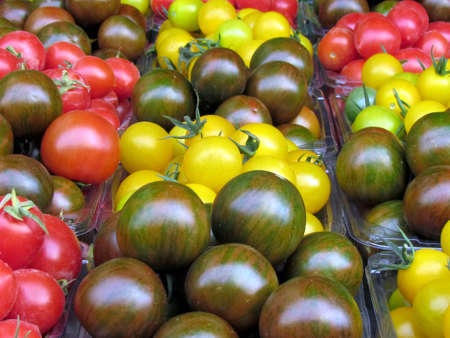 lycopene: Yellow, red and brown cherry tomatoes on bazaar in Tel Aviv, Israel                                  Stock Photo