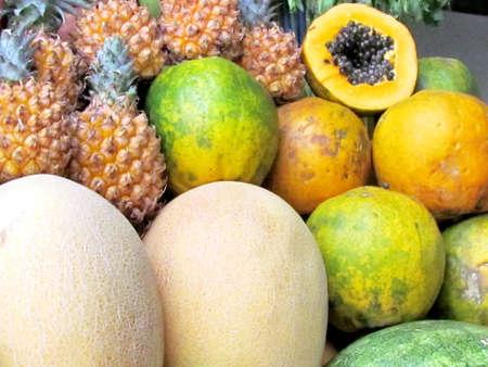 Melon, pineapple and papaya  on bazaar in Tel Aviv, Israel