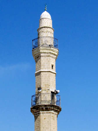 minaret:  The minaret of Great Mosque Muhamidiya Mosque against the blue sky in old city Jaffa, Israel