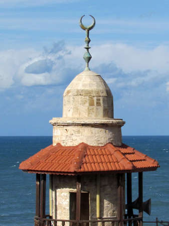 minaret: The top of the minaret of  Al-Bahr Mosque in old city Jaffa, Israel                                 Stock Photo