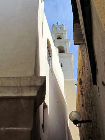 View of Belfry of St. Peters Church from Netiv HaMazolot street in old city Jaffa, Israel                               photo