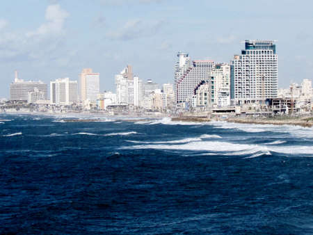 View of the stormy sea and Tel Aviv in old Jaffa, Israel                                  photo