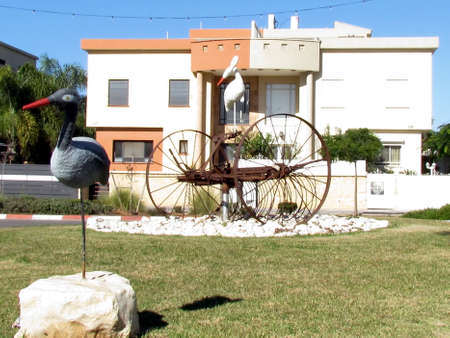 Sculptures of storks in front of residential house in quarter Neve Rabin in Or Yehuda, Israel
