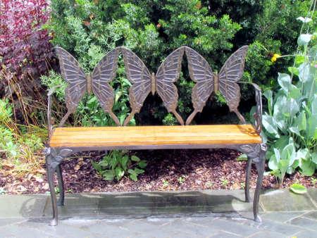 Bench with metallic butterflies in garden in Washington DC, USA                                          Stock Photo