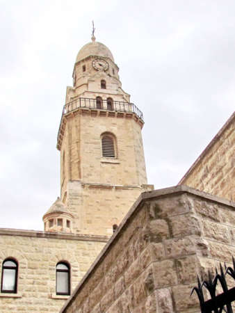 The Tower of  Dormition Abbey in cloudy weather in Jerusalem, Israel                                   photo