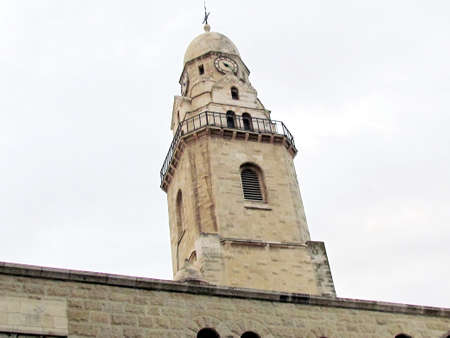 The Bell Tower of  Dormition Abbey in cloudy weather in Jerusalem, Israel