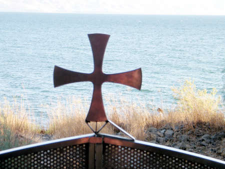 Cross in the yard of Greek Orthodox Church of the Seven Apostles in Kapernaum on the shores of Sea of Galilee in Israel