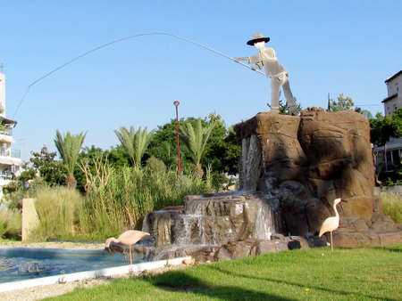Fisherman fountain on the square in Or Yehuda, Israel