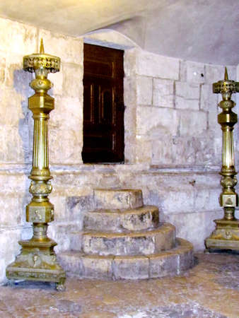 Candelabrums near ancient stage in Church of the Holy Sepulcher in Jerusalem, Israel                                 photo