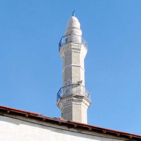 etymology: The ancient minaret of the Mahmoudiya Mosque in old city Jaffa, Israel                                 Stock Photo