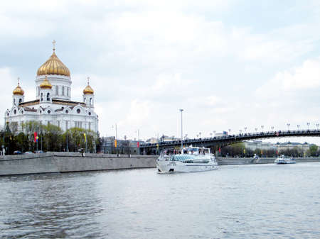 waterbus: The water-bus on Moscow river near Cathedral of Christ the Saviour in Moscow, Russia