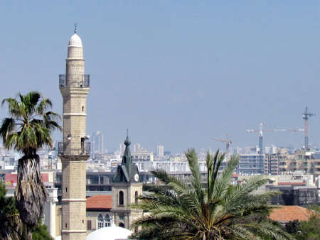 tel: View of the minaret of Mahmoudiya Mosque and Tel Aviv in old city Jaffa, Israel Stock Photo