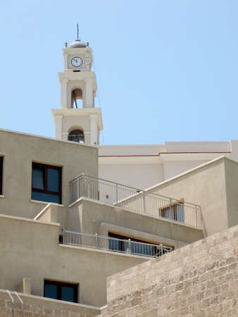New homes and Bell Tower of St. Peters Church in old city Jaffa, Israel photo