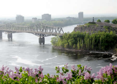 samuel: View of Samuel de Champlain statue and Alexandra Bridge Bridge over river in Ottawa, Canada