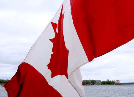 kingston: Waving flag of Canada in Kingston, lake Ontario, Canada