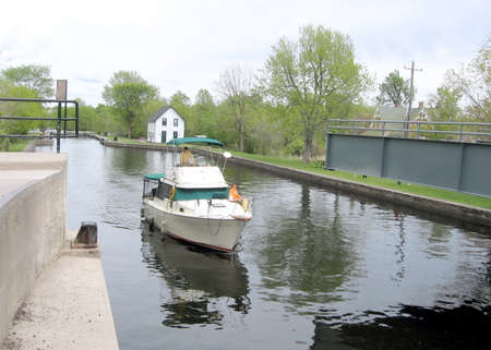 rideau canal: Boat before lock on the Rideau Canal in Merrickville of Ontario, Canada Stock Photo