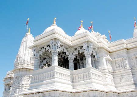 Spire and flags in Hindu temple Shri Swaminarayan Mandir in Toronto, Canada
