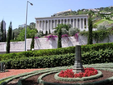 bahaullah: The flowerbed with sculpture in Bahai Gardens in Haifa, Israel