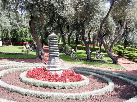 bahaullah: Flowerbed with sculpture in Bahai Gardens in Haifa, Israel
