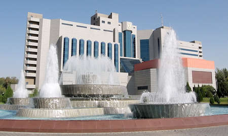 places of interest: Fountains and modern building of Yunusabad square in the city of Tashkent, the capital of Uzbekistan Editorial