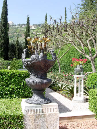 baha: Thr vase with metallic tulips in Bahai Gardens in Haifa, Israel