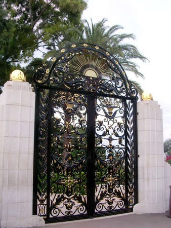bahaullah: The beautiful gate of Bahai Gardens evening in Haifa, Israel