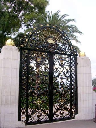 bahaullah: The beautiful gate of Bahai Gardens evening in Haifa, Israel