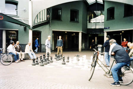 People playing chess on big chess board in the backyard of Max Euwe Centrum in Amsterdam, in 2002, Netherlands