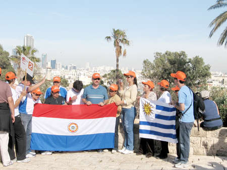 jafo: Tourists from Paraguay on the background of Tel Aviv in old Jaffa, in 2008, Israel