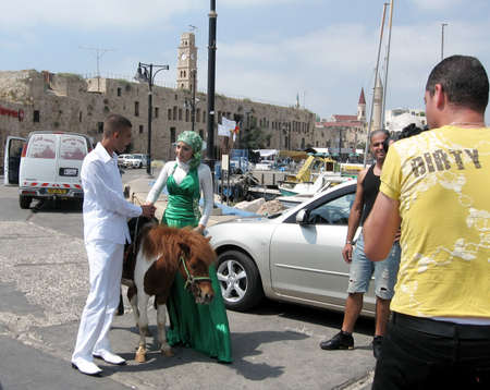 akko: Photographing of bride and groom in port of the old city of Acre, Akko, Israel Editorial