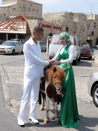 akko: Bride and groom in port of the old city of Acre, Akko, Israel