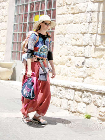 hasidic: The woman tourist on a street in old city Safed, Israel