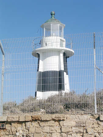 barbed wires: The lighthouse behind barbed wires in Akko, Israel