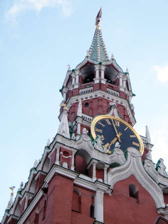 spassky: The clock of Spasskaya Tower of Moscow Kremlin evening in Moscow, Russia Stock Photo