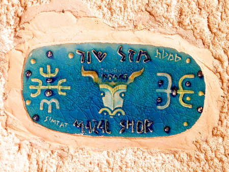 antics: Taurus zodiac sign Street Sign in old Jaffa, Israel Editorial