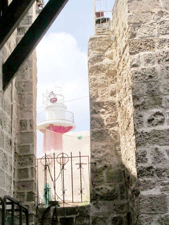 jafo: View to lighthouse from Netiv HaMazolot street in old city Jaffa, Israel