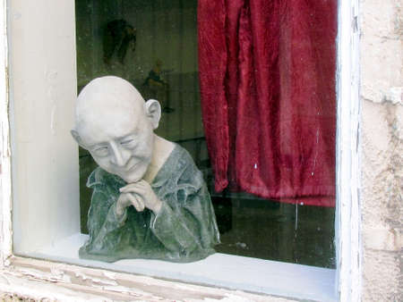 jafo: Terrible dol in the window of the house in old city Jaffa, Israel