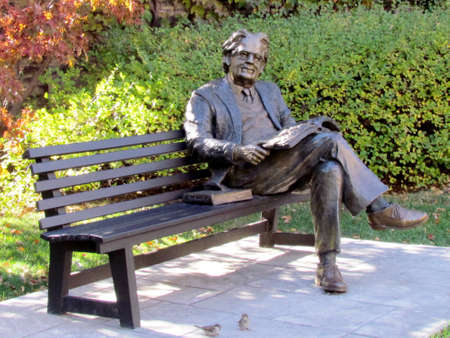 critic: Statue of literary critic Northrop Frye on a park bench at Victoria College of the University of Toronto Ontario, Canada Editorial