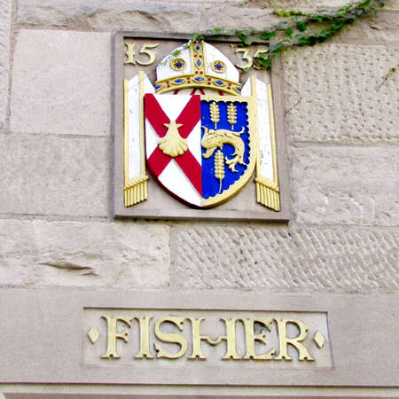 house coat: Coat arms on Fisher house of St. Michaels College in the University of Toronto Ontario, Canada Editorial