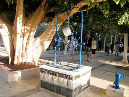 Well and Ficus religiosa in the yard of Greek Orthodox Church of the Seven Apostles in Kapernaum on the shores of Sea of Galilee in northern Israel