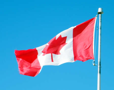 thornhill: Canadian flag waving in the blue sky above the city Thornhill Ontario, Canada