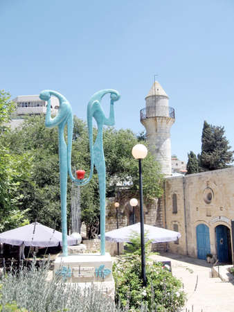spirtual: The sculpture near minaret in Old City Safed, Israel Stock Photo