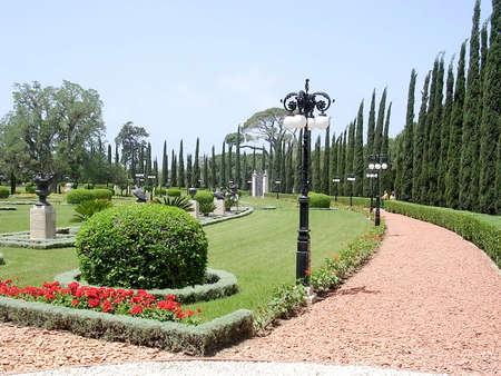 bahai: Red Path and cypress in Bahai garden in Akko, Israel