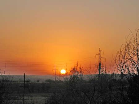 The sunset in the steppe in Tashkent region on the border between Uzbekistan and Kazakhstan