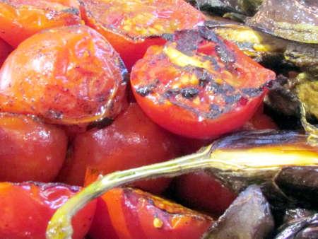 Fried tomatoes and eggplants on bazaar in Tel Aviv, Israel, July 11, 2012