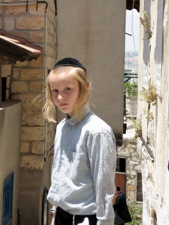 Jewish boy on a street in old city Safed, Israel, June 29, 2008 Editorial