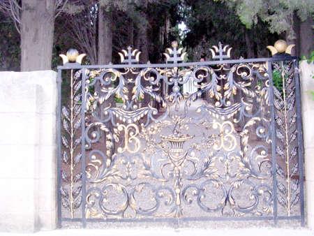 Grille gate in Bahai Gardens in Haifa, August 20, 2003 Stock Photo