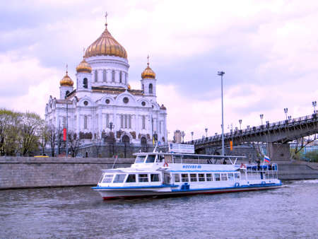 waterbus: Water-bus on Moscow river near Cathedral of Christ the Saviour at evening in Moscow, Russia, May 3, 2011 Editorial