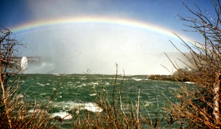 Rainbow over Canadian Falls in Niagara Falls, Canada, March 16, 2002  Sajtókép